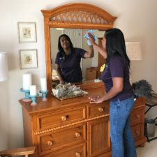cleaning mirror and shelves